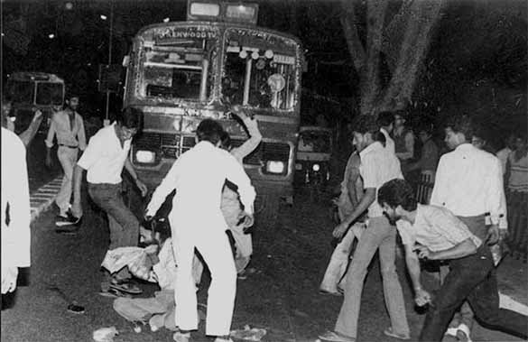 A mob beats a Sikh man. Over three days, 2,733 Sikhs were killed across Delhi in largely organised violence. (Photo: ASHOK VAHIE, Caption and Photo courtesy, Caravan Magazine)